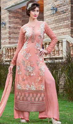 Exude unmatched elegance wearing this salmon color georgette embroidered palazzo suit. The lace and resham work appears to be chic and perfect for any celebration. #georgettepalazzodress #peachcolorpalazzosuit #floralembroidereddressdesign