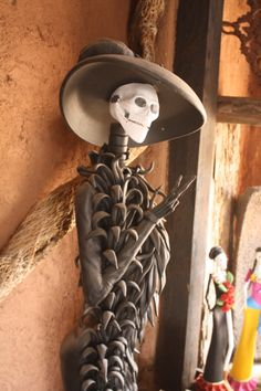Catrina - from Capula, Mexico. This is master artist quality. Just amazing.