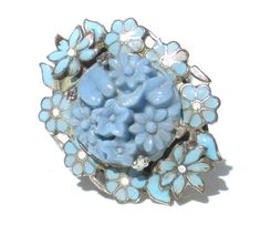 This adorable vintage ring features blue enamel flowers and molded art glass center, set on a silver tone metal. Minor enamel loss and some discoloration to the base metal.  Size 6.5, ring is 1.25 long  Please check out my shop for a vast selection of vintage and antique jewelry that ships additionally free
