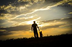 Silhouette daddy and son