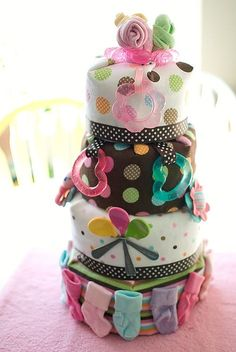Ideas for how to decorate the diaper cake.  I'm thinking of a 3 layer cake with a wrapped center layer but that could change!