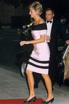 The Dress: As the Princess dabbled in more off-the-shoulder styles, her hemlines started to climb higher. The Occasion: Attending a production at the Sadlers Wells theatre, London in 1991. Why We Love It: Fashion aficionados, meet the perfect black and pink cocktail dress. Sigh.