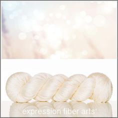 Angel Whisper luster merino tencel worsted weight yarn. YUM! A pale dreamy peachy pink ivory shade.
