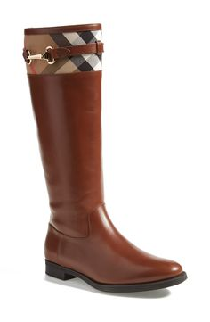 Burberry leather riding boot with plaid detail.