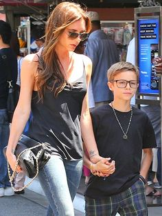 Lovin' Romeo Beckham's sleek rectangular specs! This lil dude looks oh-so-studious in his frames! We dig his momma's aviator shades too!