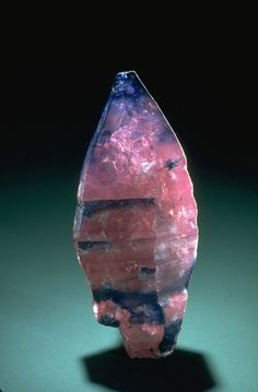 Photograph of an uncut sapphire crystal (171220) from the National Mineral…