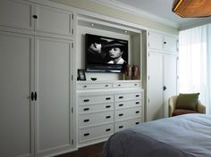 Cindy Ray Interiors: Bedroom built-ins with white built-in cabinets flanking white built-in dresser, TV and ...
