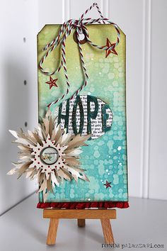 Check out @Ronda Palazzari's tutorial on the blog today that shows a water + embossing folders technique!  Find it here: http://sizzixblog.blogspot.com/2012/12/hope-tag.html