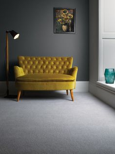 Funky sofa highlighting our Castlemead Twist CD125 Cool Grey coordinated with Dark Lead Colour 118 and French grey - Pale 161 by The Little Greene Paint Company