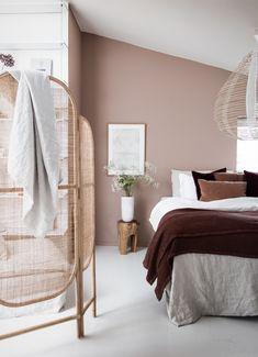 my scandinavian home: My Latest Bedroom Update (+ Get The Look!) - rattan screen, pink-brown walls, Burgundy throw.