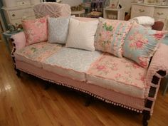 shabby chic slipcovered sofa vintage chenille and roses fabrics  living room