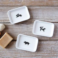 NEW! These ceramic Icon Bath Trays feature fun designs which bring a charming touch to bathroom countertops.