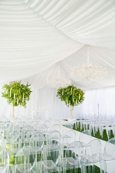 With some help, your tented ceremony can be converted into a tented reception as well. www.DistinctiveEventRentals.com