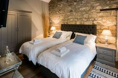 Doesn't the open stonework look incredible? A bedroom at Coach House, Lesbury.