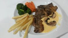 Sirloin steak with cheese sauce