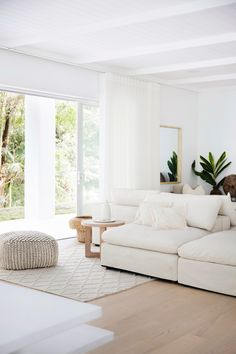 The lounge area—House 10. By Three Birds Renovations x Sophie Bell, featuring Dulux White on White.