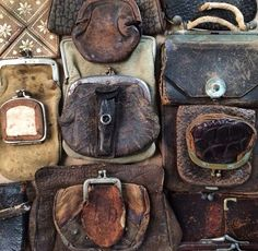 Vintage leather coin purses displayed by Rebecca Purcell