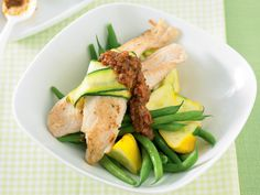 We used bass fillets here, but you can use any firm white fillet for this zucchini wrapped fish by recipes+. The sun-dried tomato pesto accompaniment adds a burst of colour and flavour. Tomato Pesto, Sun Dried, Zucchini, Bass, Colour, Canning, Chicken, Dinner, Breakfast