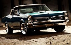 This 1966 Pontiac GTO was my grandmother's car in white. It had glitter plastic seats. Memories...