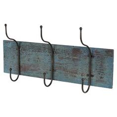 """Iron and wood three-hook wall décor with a distressed blue finish.   Product: Wall hookConstruction Material: Iron and woodColor: BlueFeatures: Three hooksDimensions: 13.5"""" H x 28"""" W x 5.5"""" D"""