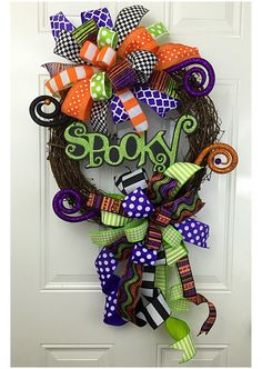This grapevine wreath was made in a smoke free home, There are two large funky bows used to made this wreath beautiful. There is a sign placed in the middle that screams SPOOKY. Also, to give the wreath its finishing touches, I have added 4 curly Halloween picks. This colorful wreath is bound to make your door look amazing for Halloween!! This wreath measure 20x20 inches round.
