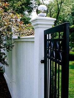 white fence with black gates - Google Search