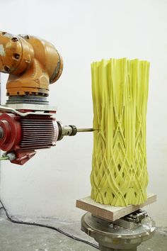 """A milling machine, with a six-axis robotic arm, carves into a piece of contemporary art. """"With current technology, subtracting is better than adding,"""" Lowe said.                                                                                                                                                                                 More"""