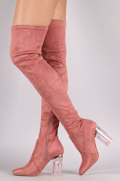 These over-the-knee boots feature a soft vegan suede upper and chunky lucite heel. Finished with a cushioned insole, smooth lining, and partial side zipper closure for easy on/off. Material: Vegan Sue
