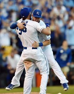 Oct 15, 2014; Kansas City, MO, USA; Kansas City Royals infielders Eric Hosmer (35) and Mike Moustakas (8) celebrate after defeating the Baltimore Orioles in game four of the 2014 ALCS playoff baseball game at Kauffman Stadium. The Royals swept the Orioles to advance to the World Series. (Peter G. Aiken-USA TODAY Sports)