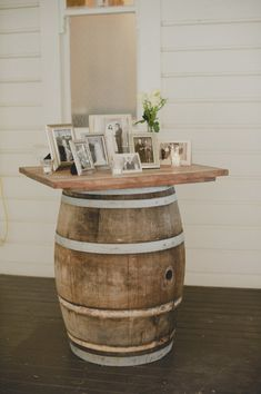 Barrel with wood top to display family photos. Great for parent and grandparent wedding memories.