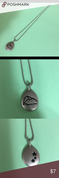 Teardrop necklace Looks like a mountain scene on one side and stars in the other side of this adorable necklace. The chain is very reflective and sparkles. Some wear on the mountain side as pictured. Chain measures 16 inches. Teardrop measures about 3/4 inch long and wide. Jewelry Necklaces