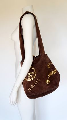 Excited to share the latest addition to my #etsy shop: Moschino by Redwall vintage suede leather brown shoulder bag sac gold letters moschino http://etsy.me/2mTuhly #bagsandpurses #bronze #moschino #moschinovintage #moschinoredwall #moschinobag #moschinosac #moschinole