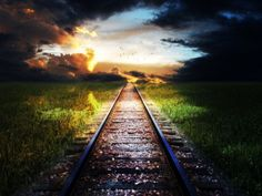railroad tracks; i walk this path alone traveled by hundreds ...