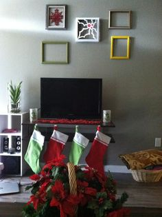 Easy Christmas DIY. old pizza box with a cut-out holly design. Beads placed in front of the Tv.