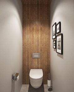 Super tof idee voor in het toilet! Trek de muurafwerking achter het toilet helemaal door tot en met het plafond! [via @decoist]#interieurinspiratie #interiordesign #toilet #interieur #interior #badkamerinspiratie