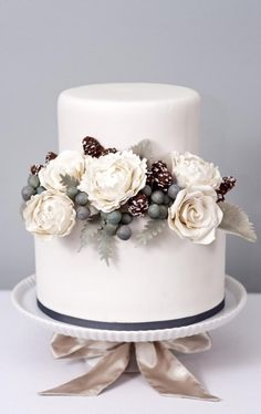 Wintery White Sugar Cake Bouquet By EricaObrienCake on CakeCentral.com  Sugar roses, peonies, pinecones, silver brunia, dusty miller. All edible!
