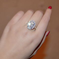 """""""Celebrity"""" 6 Carat Oval Engagement Ring in White Gold Plated Halo Setting"""