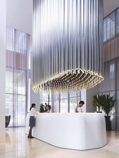 Studio M Hotel reception area in Singapore | The lighting fixture is absolutely stunning. | Find more inspiring lighting designs and solutions for your hospitality projects at Unique Blog http://delightfull.eu/blog/