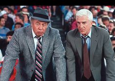 "Leslie Nielsen & George Kennedy in ""The Naked Gun: From the Files of Police Squad!"" (1988)"