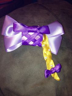 Disneys tangled inspired Rapunzel bow  by BrookeHyland345 on Etsy, $6.00