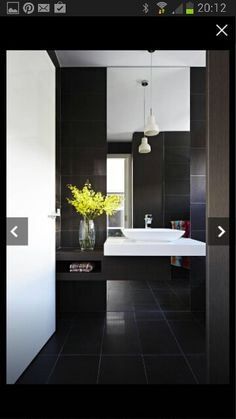 Great contrast of black & white for master ensuite.