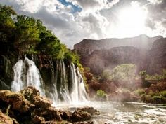One mile past the Supai Village, you will get your first glimpse of the breathtaking Upper Navajo Falls, which tumble over a 50-foot sheer cliff. Photo by Travis Burke