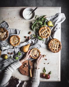 baking table with hands. apple pies and tarts #foodphotography #foodstyling