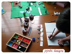 Recording sentences made from the grammar farm using the Montessori grammar symbols