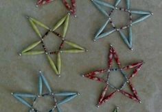 Star shaped ornaments made from hand rolled paper beads. These ornaments are made using 2 inch beads and coordinating 1/2 inch beads.