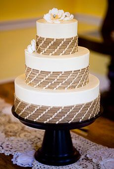 The buttercream decorations on this three-tier cake by Charleston-based baker Jim Smeal were designed to resemble rustic sea grass; sugar magnolias were the finishing touch.