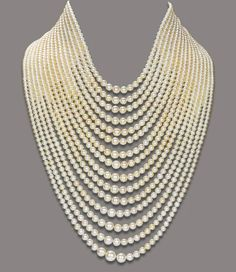 Composed of fifteen strands of graduated natural pearls, to the diamond-set bar and chain clasp, mounted in gold est value ($175,812 - $219,765)