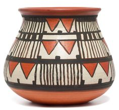 "Flora Cable Huckfield vase, red clay with a geometric design, signed Huckfield, Santa Barbara, 5""h, sister of Margret Cable; with a NDSM bowl, (not shown), small footed form with a floral design, signed Huck 1216, marked, 4.25""w"