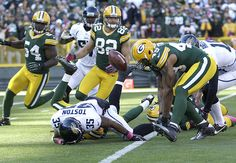 There's a scramble for the ball after the Packers blocked a Bryan Anger punt. Dezman Moses (54) would eventually recover it in the end zone for Green Bay's first touchdown off a blocked punt since 1990.