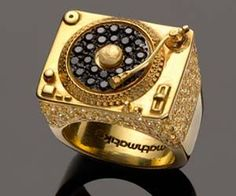 Redefine what fine jewelry means with the turntable ring. This unnecessarily gaudy piece of flare will allow you to flaunt your excessive wealth like never...